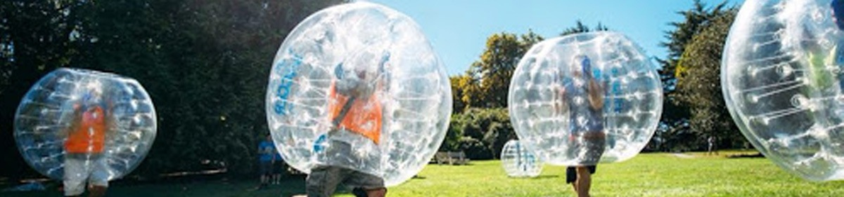 Group playing a game of bubble soccer