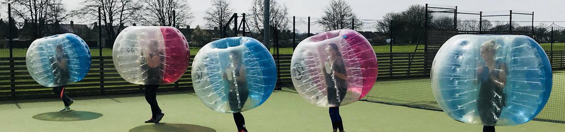 Women in giant bubble balls